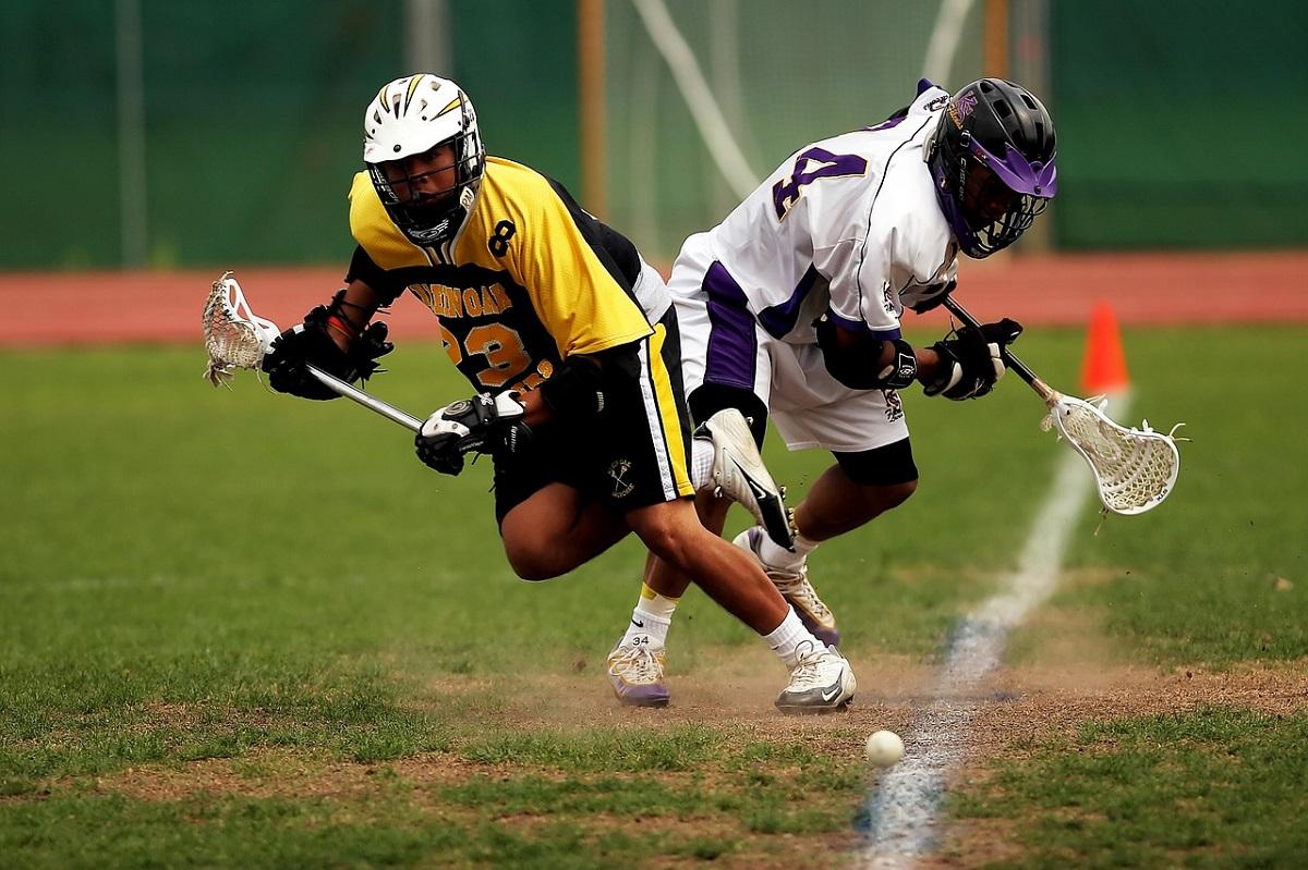 Lacrosse players on field