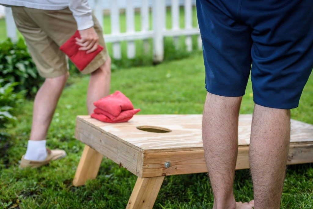 Men playing cornhole